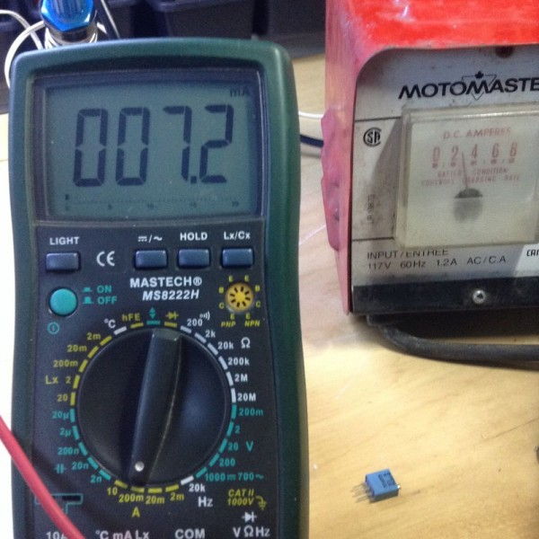 To the left is the current draw of the control circuitry. To the right is the 12V battery charger putting out 3A